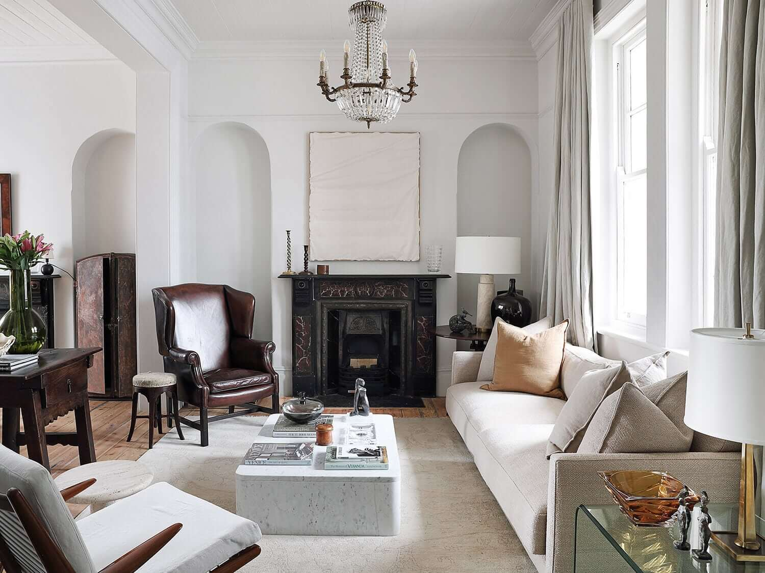 Sophisticated living room with fireplace and carpet over the wooden floor, photograph by Elsa Young