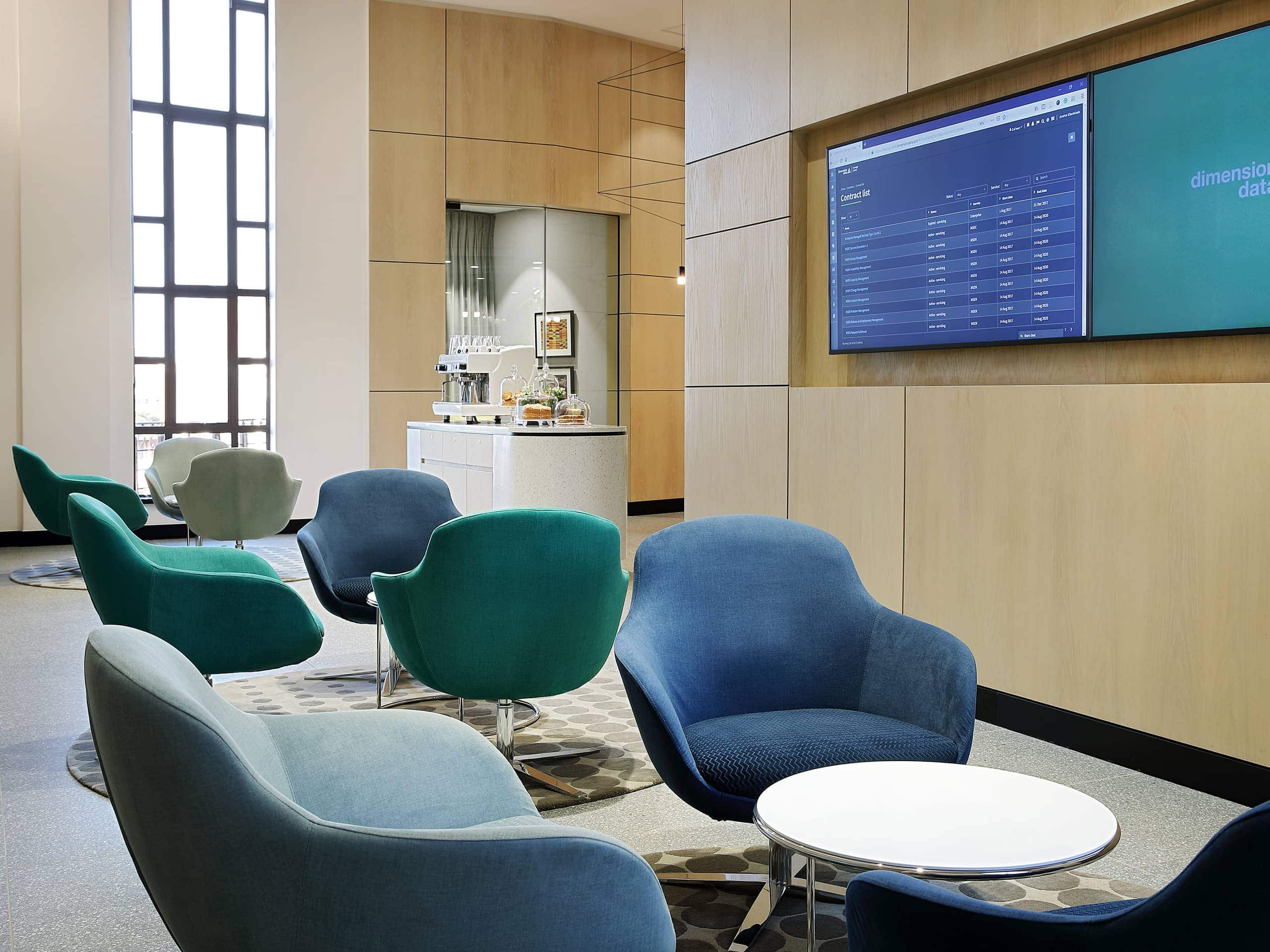 Modern airport members' lounge with comfortable armchairs and food station. Elsa Young Photography.