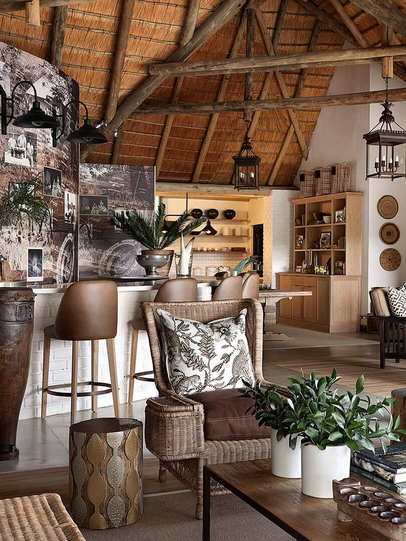 Guest living area with comfortable armchairs and bar, Londolozi Private Game Reserve. Photo by Elsa Young.