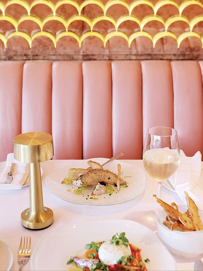 A colourfully bright upholstered banquette at Tashas Restaurant. Elsa Young Photography.
