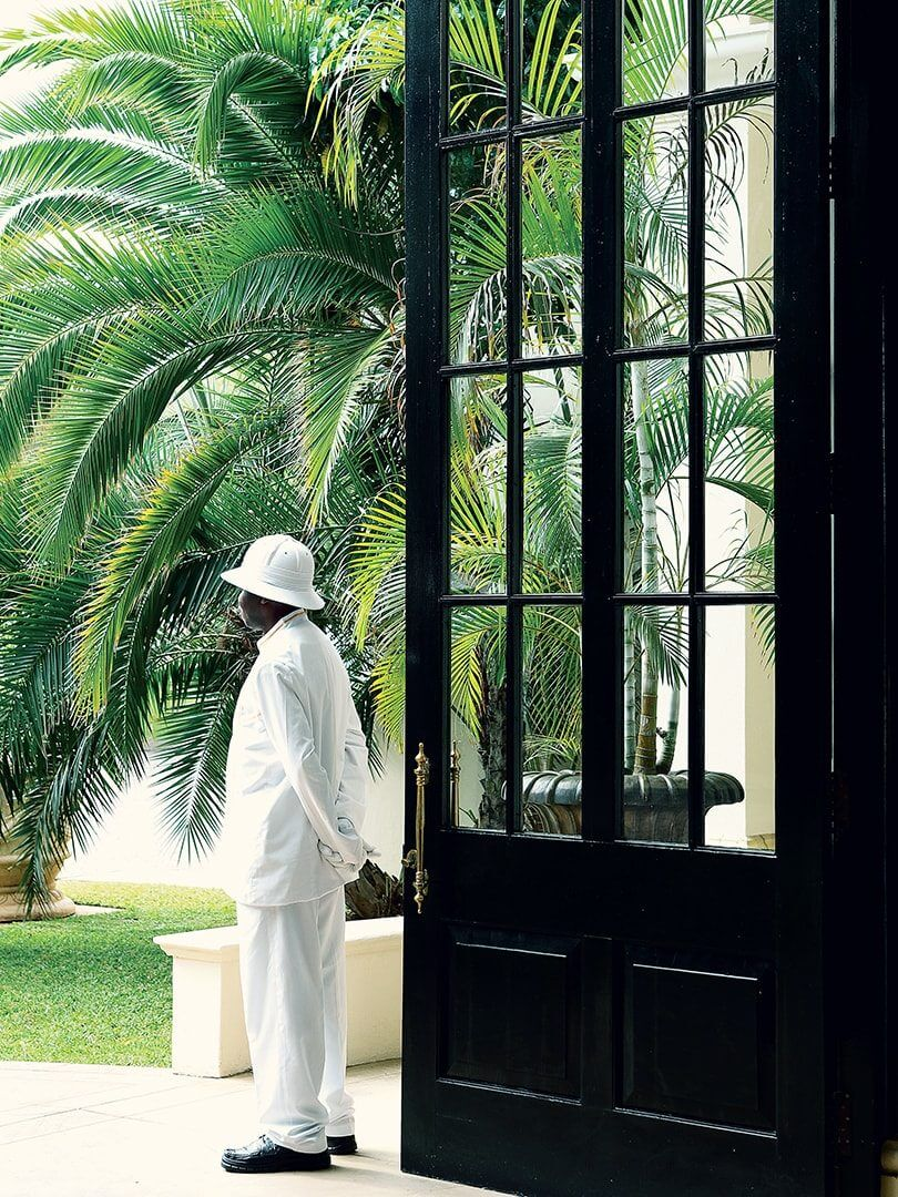 Porter standing outside the Royal Livingstone hotel. Photo by Elsa Young.