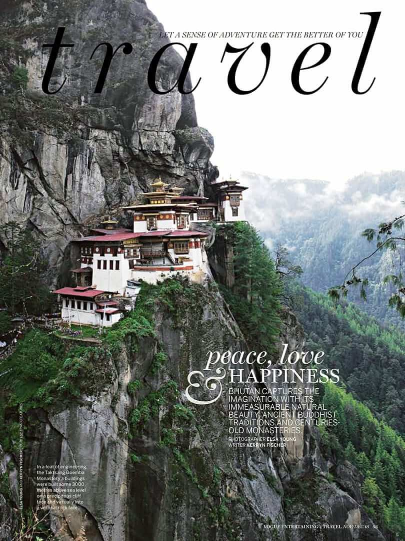 Magazine cover showing a Bhutanese monastery clinging to a sheer cliff face. Photo by Elsa Young.