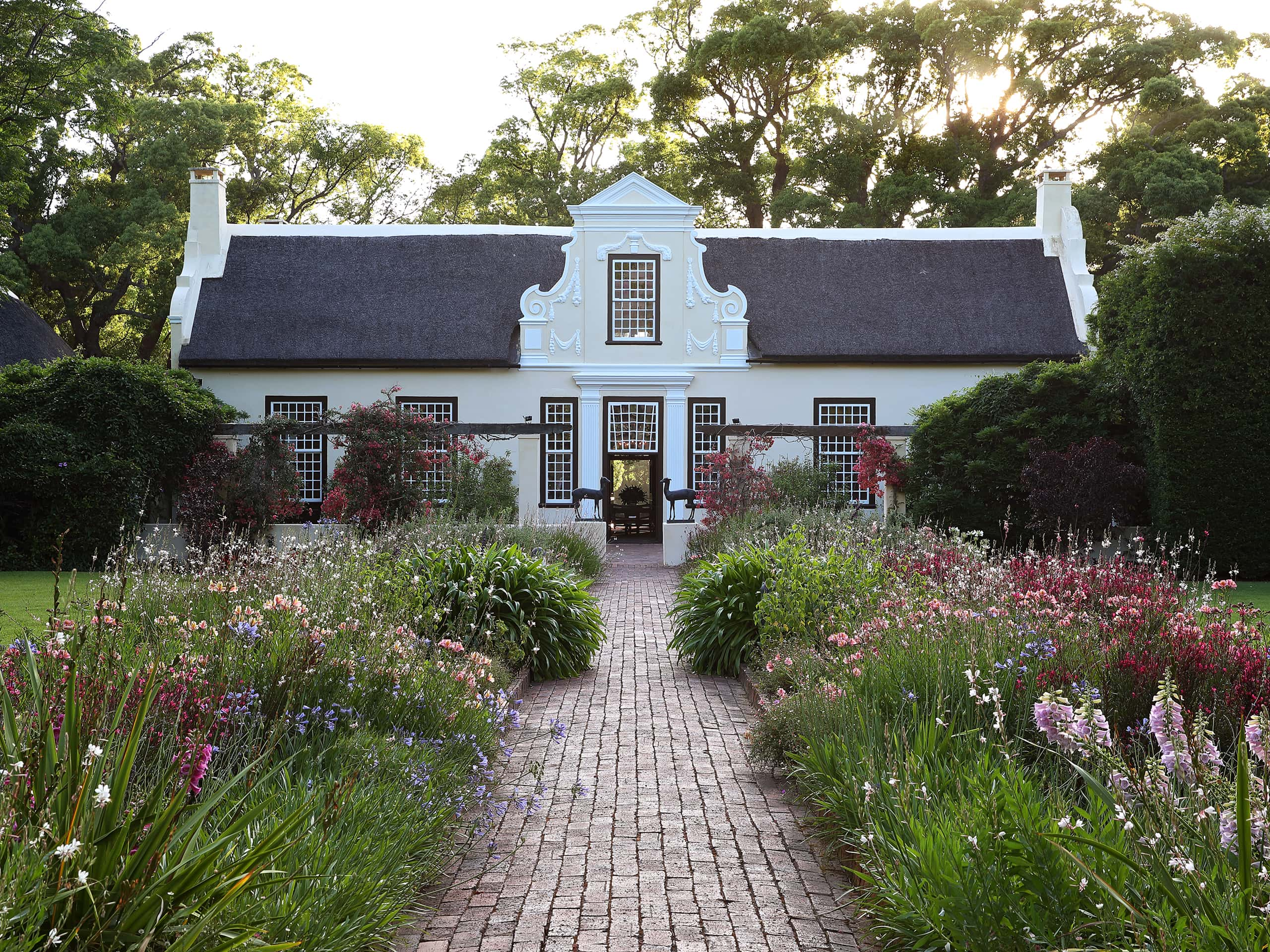 Exquisite Cape Dutch building in the bucolic gardens of Vergelegen, Western Cape. Photo by Elsa Young.