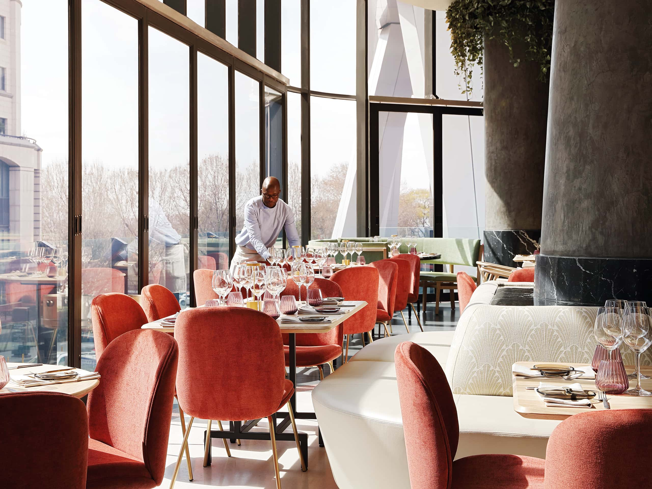 Waier setting tables at Saint Restaurant in Johannesburg. Photograph by Elsa Young.