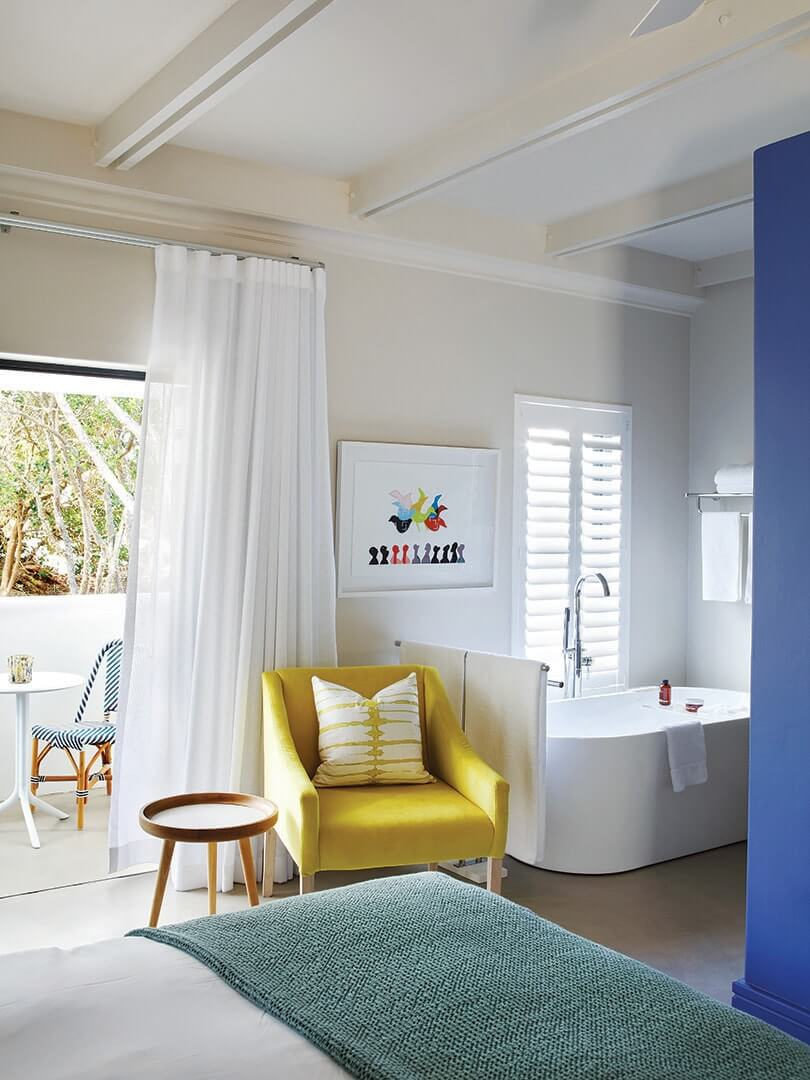 Colourful, contemporary bedroom at The Old Rectory in Plettenberg Bay. Photo by Elsa Young.