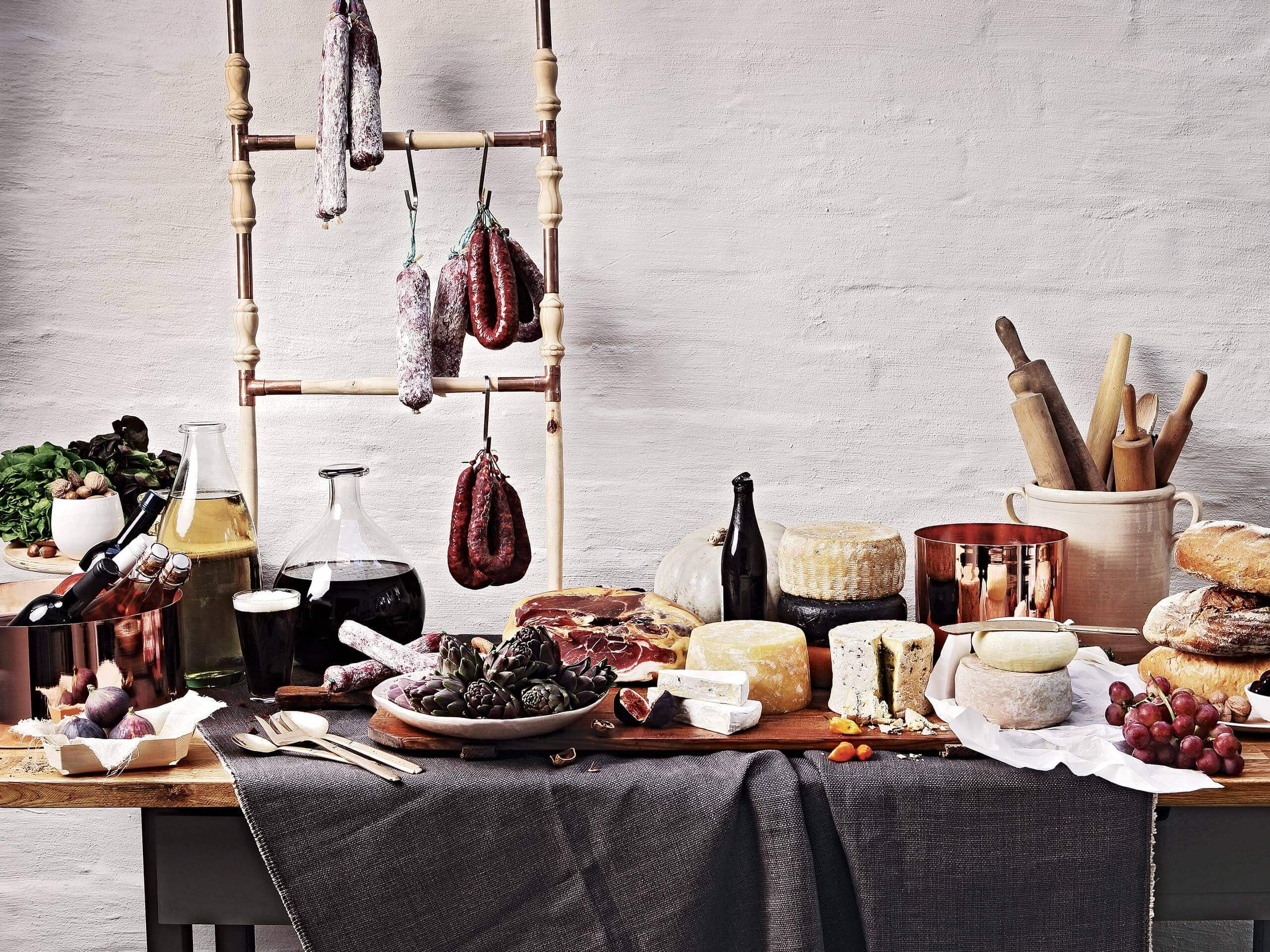 A delectable spread of wines, oils, cheeses, meats, fruits and breads. Elsa Young Photography.
