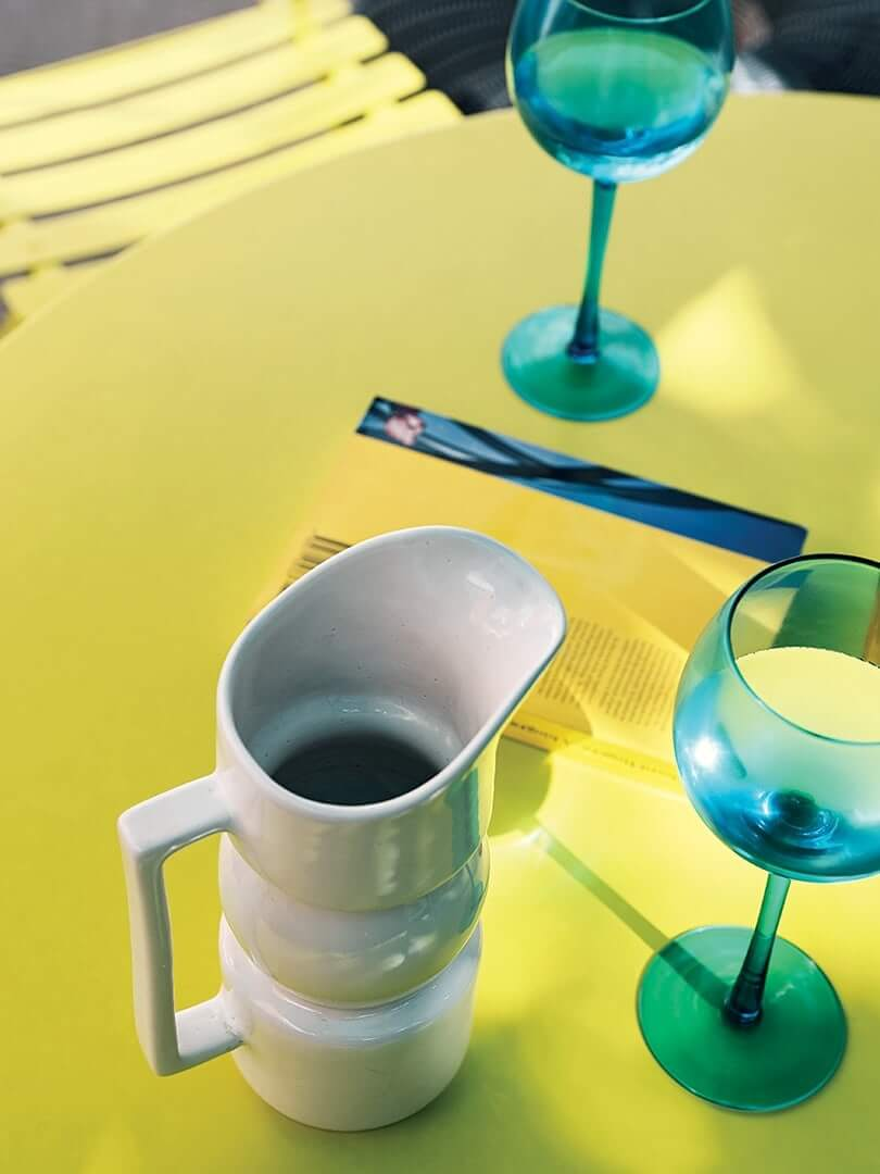 Wine carafe and glasses on a table.