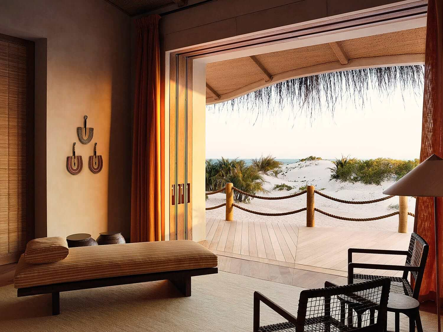 Looking out from a luxury suite to the sand dunes and ocean outside at Kisawa Sanctuary, Mozambique. Photo by Elsa Young.