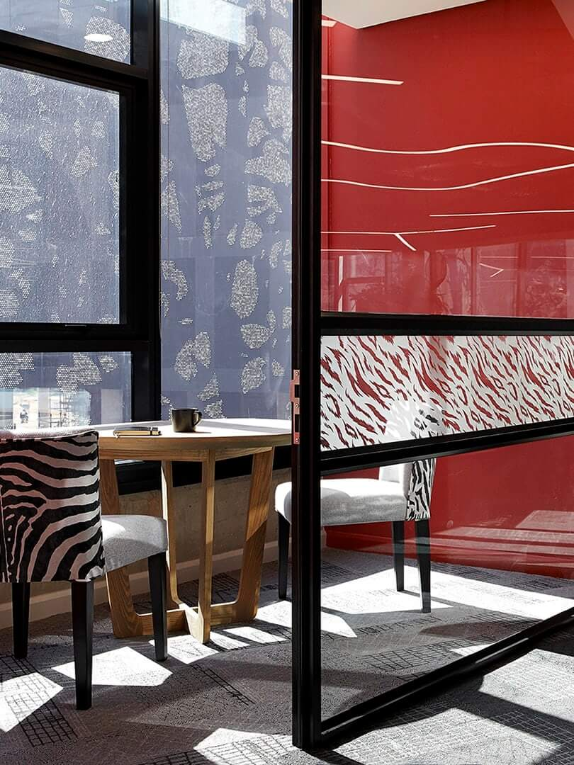 Modern African-inspired office's small meeting room.